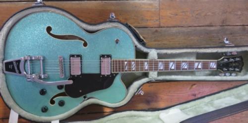 Grønn sparkle gitar